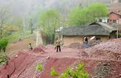 Manganese ore dump and village near Sishang, Shaanxi