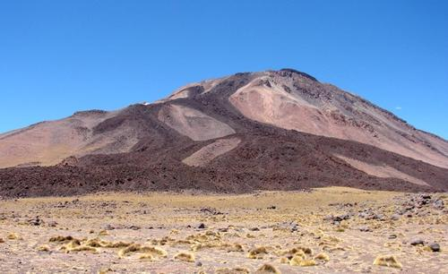 Tuzgle stratovolcano, Argentina. Recent dark andesitic lava flows can be clearly seen on the slopes