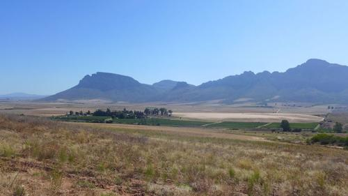 Land cover in the Krom Antonies catchment: Fallow in the foreground, irrigated fields and natural wetlands in the middle-ground and natural Fynbos vegetation in the background